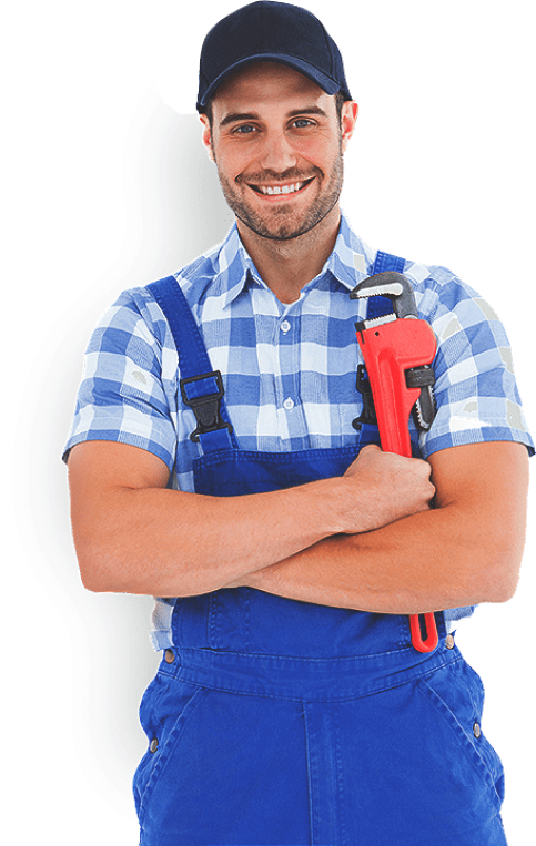 A plumbing worker with equipment in hand