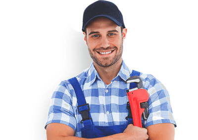 A plumber with equipment in hand