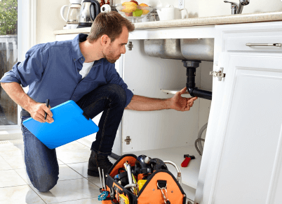 A plumber is repairing the kitchen sink